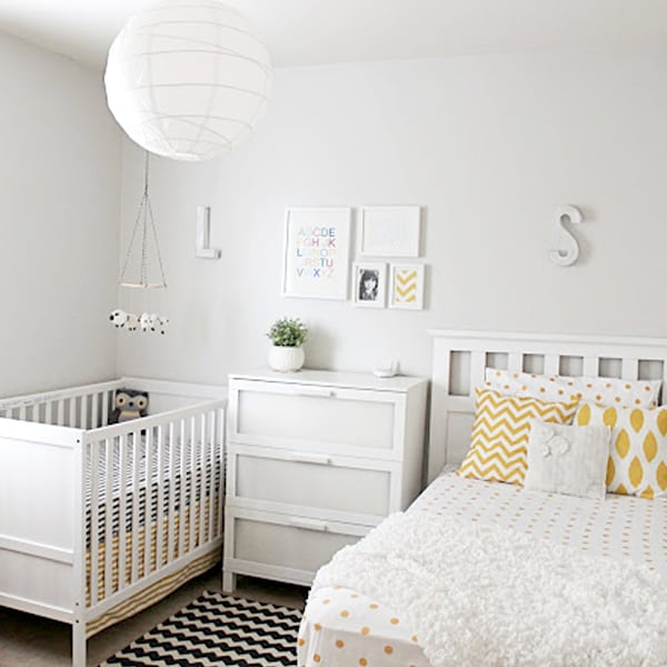 matching patterns in a white master bedroom and nursery combo